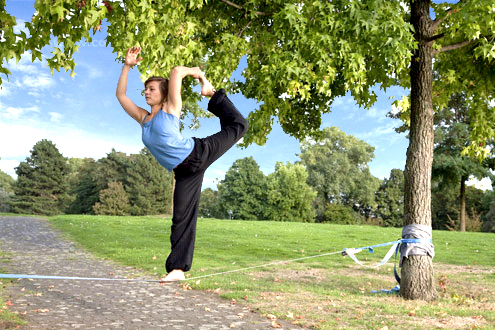 Slackline Series - Young Woman In The Park